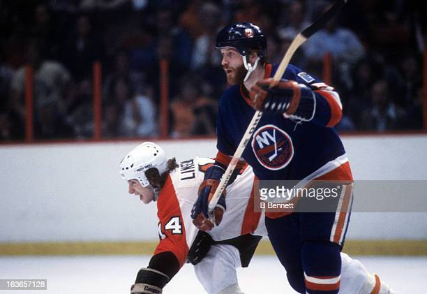 Denis Potvin of the New York Islanders battles with Ken Linseman of the Philadelphia Flyers during the 1980 Stanley Cup Finals in May 1980 at the...