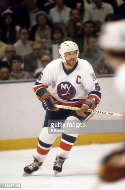 Denis Potvin of the New York Islanders skates on the ice during an NHL game circa 1980 at the Nassau Coliseum in Uniondale New York