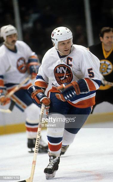 Denis Potvin of the New York Islanders skates on the ice during an NHL game against the Boston Bruins circa 1981 at the Nassau Coliseum in Uniondale...