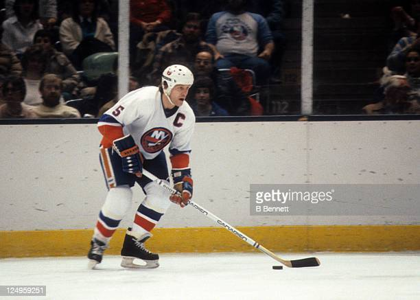 Denis Potvin of the New York Islanders skates with the puck during an NHL game against the Minnesota North Stars on February 5 1983 at the Nassau...