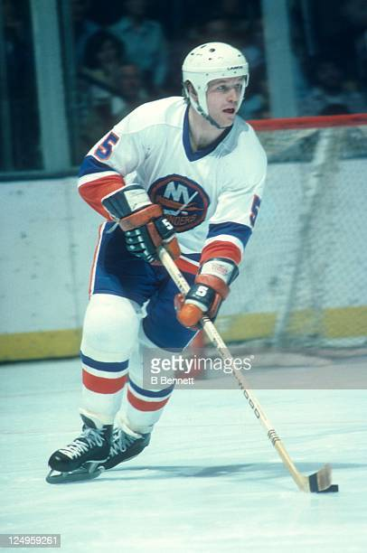 Denis Potvin of the New York Islanders skates with the puck during an NHL game in April 1977 at the Nassau Coliseum in Uniondale New York