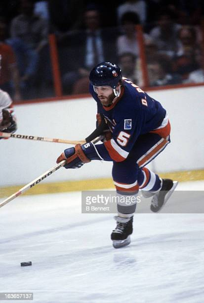 Denis Potvin of the New York Islanders skates with the puck during the 1980 Stanley Cup Finals against the Philadelphia Flyers in May 1980 at the...