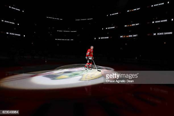 Denis Savard hockey Hall of Famer is honored during the Chicago Blackhawks 'One More Shift' campaign prior to the game against the Montreal Canadiens...