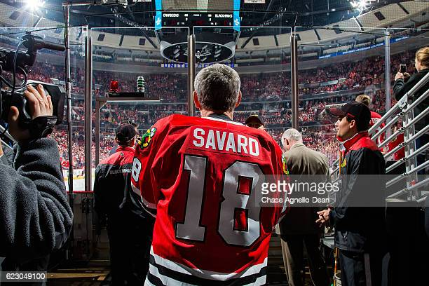 Denis Savard hockey Hall of Famer prepares to enter the ice before being honored during the Chicago Blackhawks 'One More Shift' campaign prior to the...