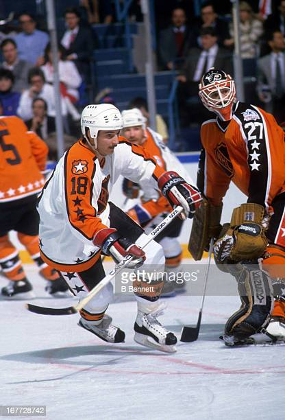 Denis Savard of the Campbell Conference and the Chicago Blackhawks skates in front of goalie Ron Hextall of the Wales Conference and the Philadelphia...
