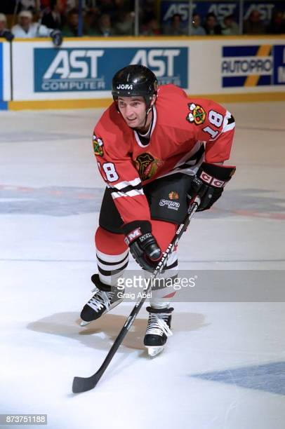 Denis Savard of the Chicago Black Hawks skates against the Toronto Maple Leafs during NHL game action on December 20 1995 at Maple Leaf Gardens in...