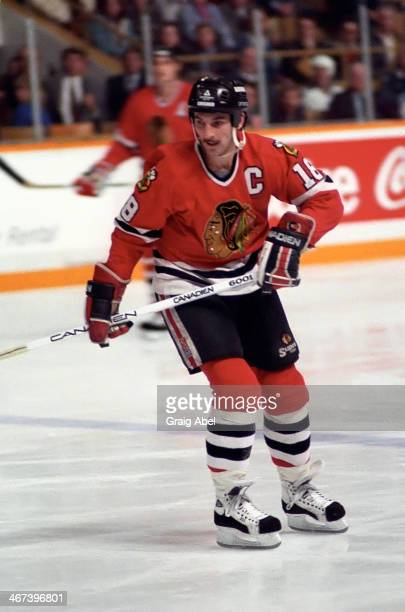 Denis Savard of the Chicago Black Hawks skates up ice against the Toronto Maple Leafs at Maple Leaf Gardens in Toronto Ontario Canada on November 23...