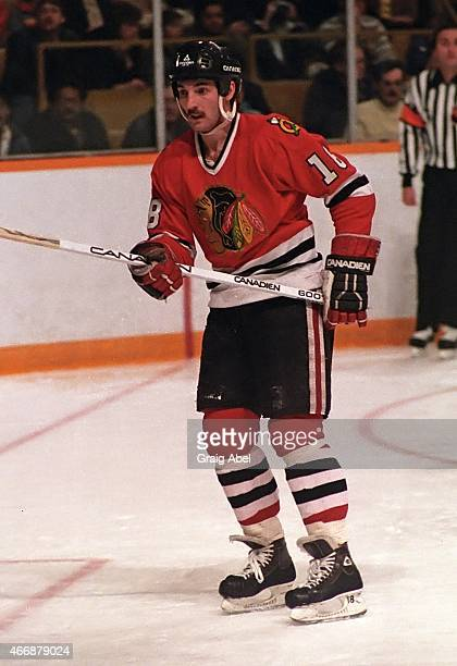 Denis Savard of the Chicago Black Hawks watches the play against the Toronto Maple Leafs during NHL game action at Maple Leaf Gardens in Toronto...