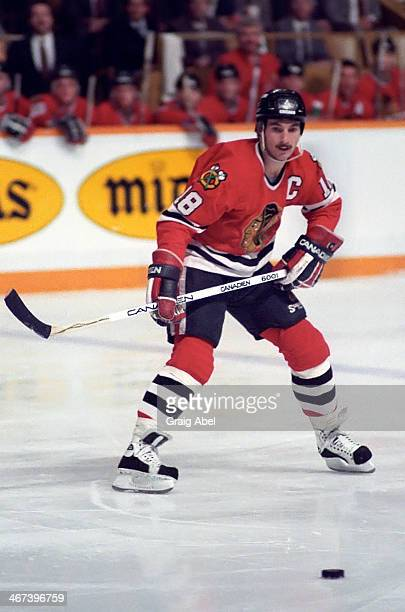 Denis Savard of the Chicago Black Hawks watches the play against the Toronto Maple Leafs at Maple Leaf Gardens in Toronto Ontario Canada on November...