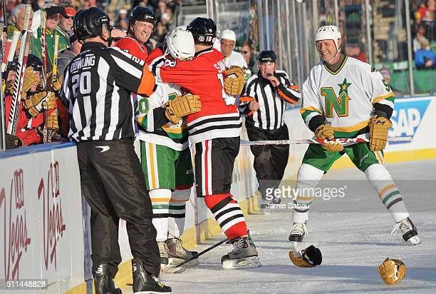 Denis Savard of the Chicago Blackhawks Alumni and Dino Ciccarelli of the Minnesota North Stars Alumni play fight during the 2016 Coors Light Stadium...