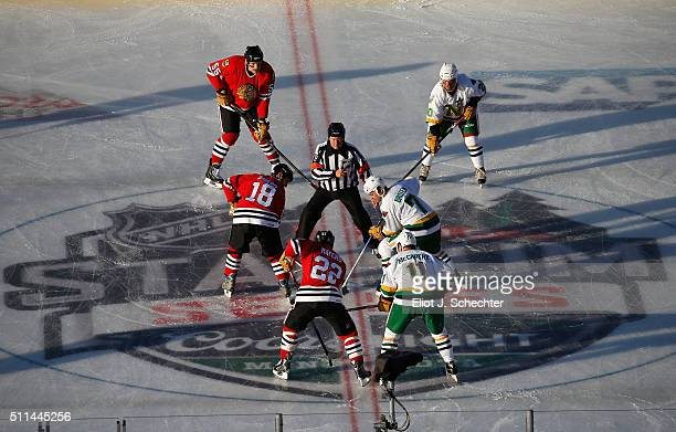 Denis Savard of the Chicago Blackhawks Alumni and Neal Broten of the Minnesota North Stars Alumni take the opening faceoff during the 2016 Coors...