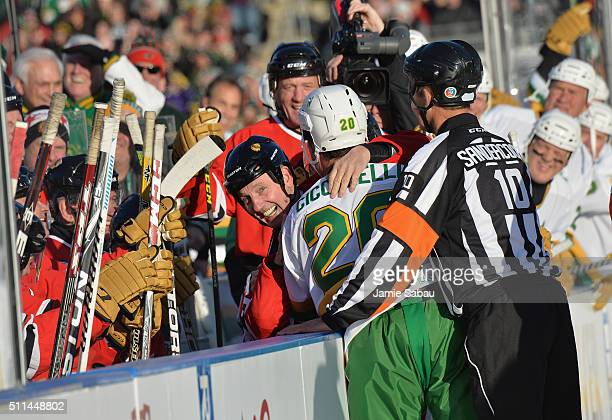 Denis Savard of the Chicago Blackhawks Alumni laughs as he play fights with Dino Ciccarelli of the Minnesota North Stars Alumni during the 2016 Coors...