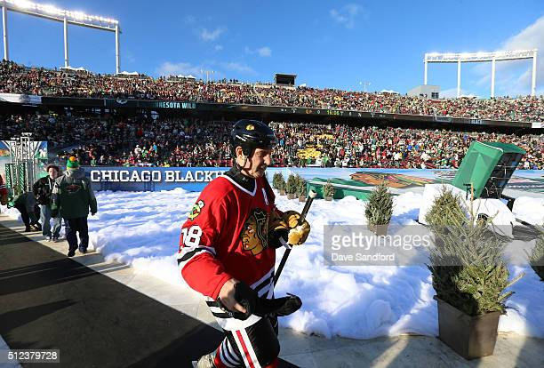 Denis Savard of the Chicago Blackhawks Alumni makes his way to the ice prior to the 2016 Coors Light Stadium Series Alumni Game between the Chicago...