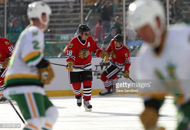 Denis Savard of the Chicago Blackhawks Alumni wears sunglasses during warmup prior to the 2016 Coors Light Stadium Series Alumni Game between the...