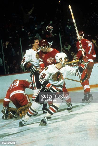 Denis Savard of the Chicago Blackhawks celebrates a goal during an NHL game against the Detroit Red Wings circa 1985 at the Chicago Stadium in...