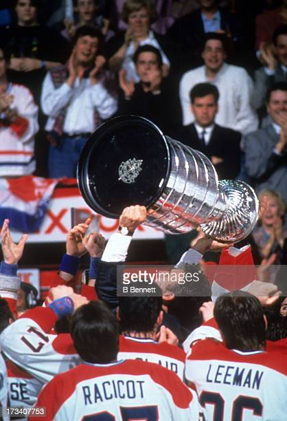 Denis Savard of the Montreal Canadiens celebrates with the Stanley Cup Trophy after defeating the Los Angeles Kings in Game 5 of the 1993 Stanley Cup...