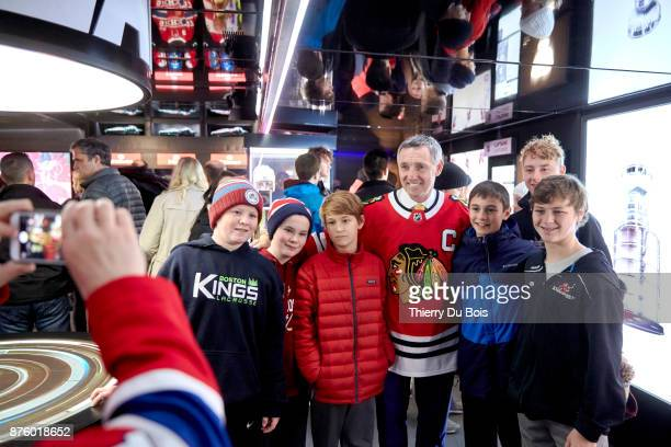 Denis Savard poses with the fans during the NHL Centennial 100 Celebration on November 18 2017 at the Bell Centre in Montreal Quebec Canada