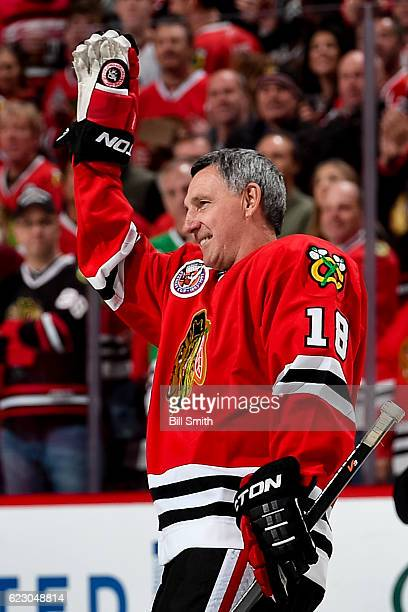Denis Savard waves to the crowd while being honored during the Chicago Blackhawks 'One More Shift' campaign prior to the game against the Montreal...