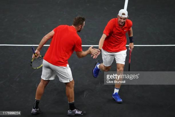 Denis Shapovalov and Jack Sock of Team World celebrate during their doubles match against Roger Federer and Alexander Zverev of Team Europe during...