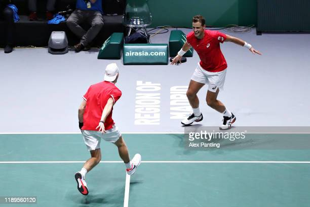Denis Shapovalov and Vasek Pospisil of Canada celebrate victory in the semi final doubles match between Russia and Canada during Day Six of the 2019...