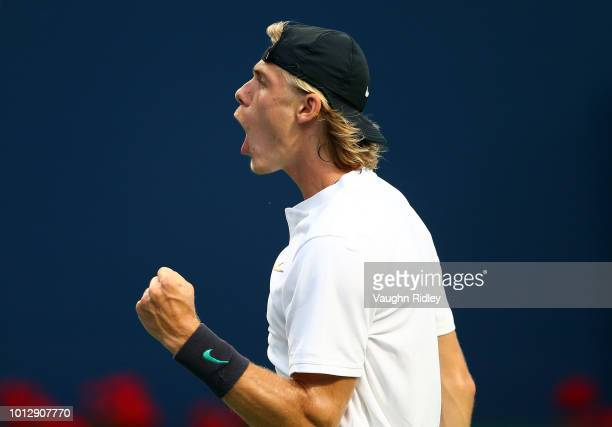 Denis Shapovalov of Canada celebrates a point against Jeremy Chardy of France during a 1st round match on Day 2 of the Rogers Cup at Aviva Centre on...