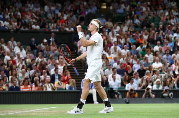 Denis Shapovalov of Canada celebrates after winning match point during his men's singles third round match against Andy Murray of Great Britain on...