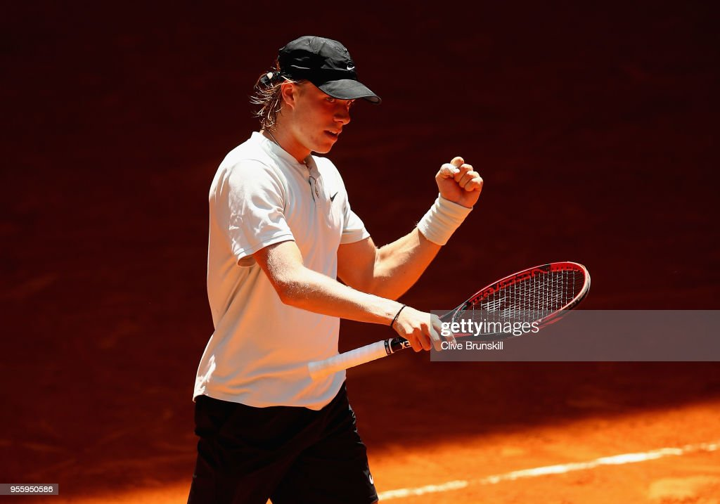 Denis Shapovalov of Canada celebrates match point against Benoit Paire of France in their second round match during day four of the Mutua Madrid Open tennis tournament at the Caja Magica on May 8, 2018 in Madrid, Spain.