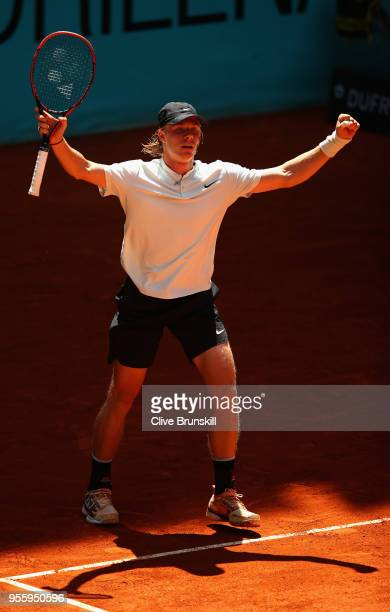 Denis Shapovalov of Canada celebrates match point against Benoit Paire of France in their second round match during day four of the Mutua Madrid Open...