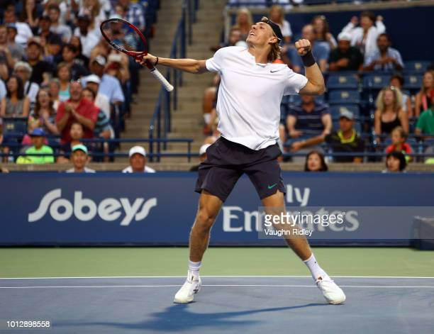 Denis Shapovalov of Canada celebrates victory over Jeremy Chardy of France following a 1st round match on Day 2 of the Rogers Cup at Aviva Centre on...