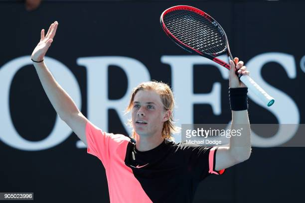 Denis Shapovalov of Canada celebrates winning his first round match against Stefanos Tsitsipas of Greece on day one of the 2018 Australian Open at...