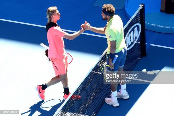 Denis Shapovalov of Canada congratulates JoWilfried Tsonga of France after Tsonga won their second round match on day three of the 2018 Australian...
