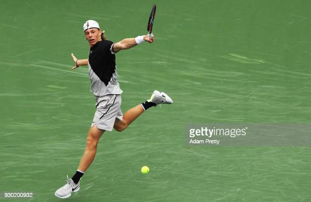 Denis Shapovalov of Canada hits a backhand during his match against Pablo Cuevas of Uruguay during the BNP Paribas Open at the Indian Wells Tennis...