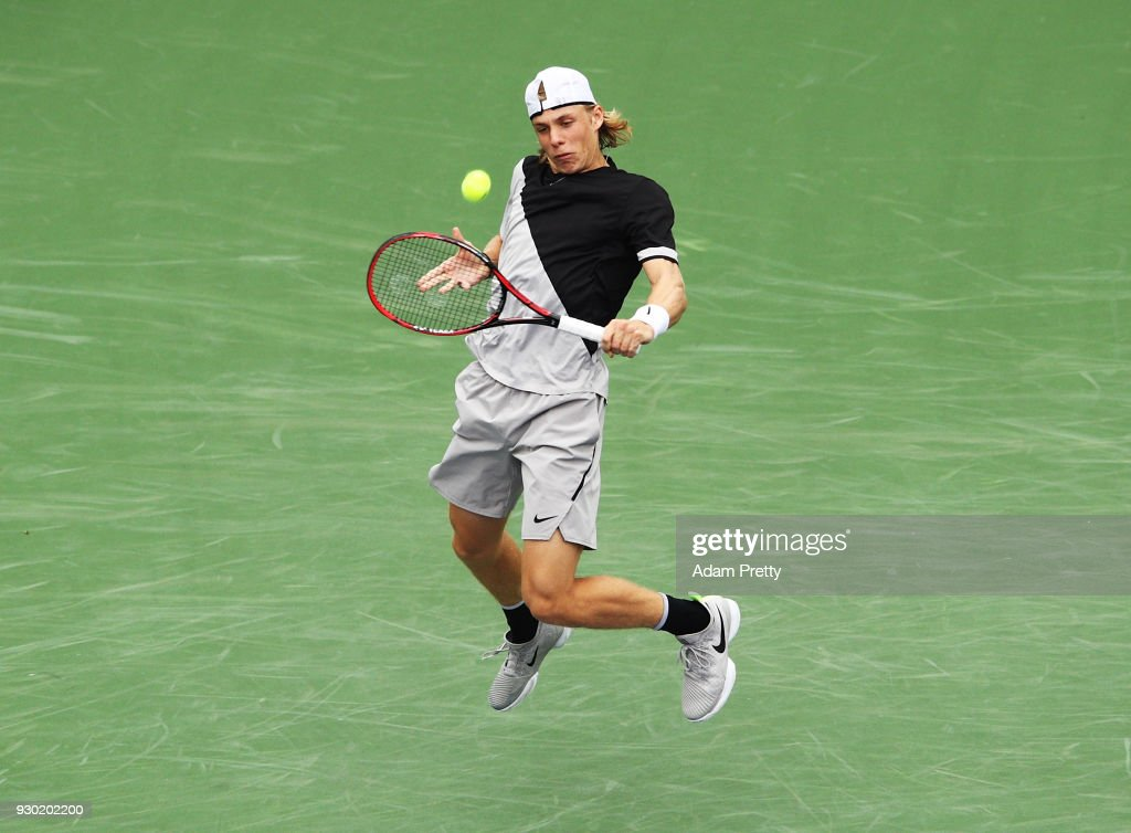Denis Shapovalov of Canada hits a backhand during his match against Pablo Cuevas of Uruguay during the BNP Paribas Open at the Indian Wells Tennis Garden on March 10, 2018 in Indian Wells, California.