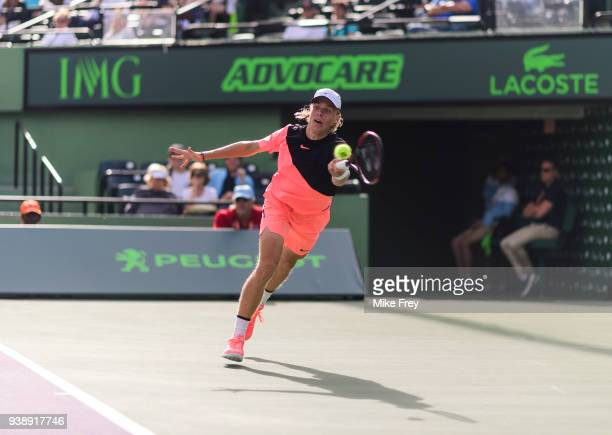 Denis Shapovalov of Canada hits a forehand to Borna Coric of Croatia during Day 9 of the Miami Open Presented by Itau at Crandon Park Tennis Center...