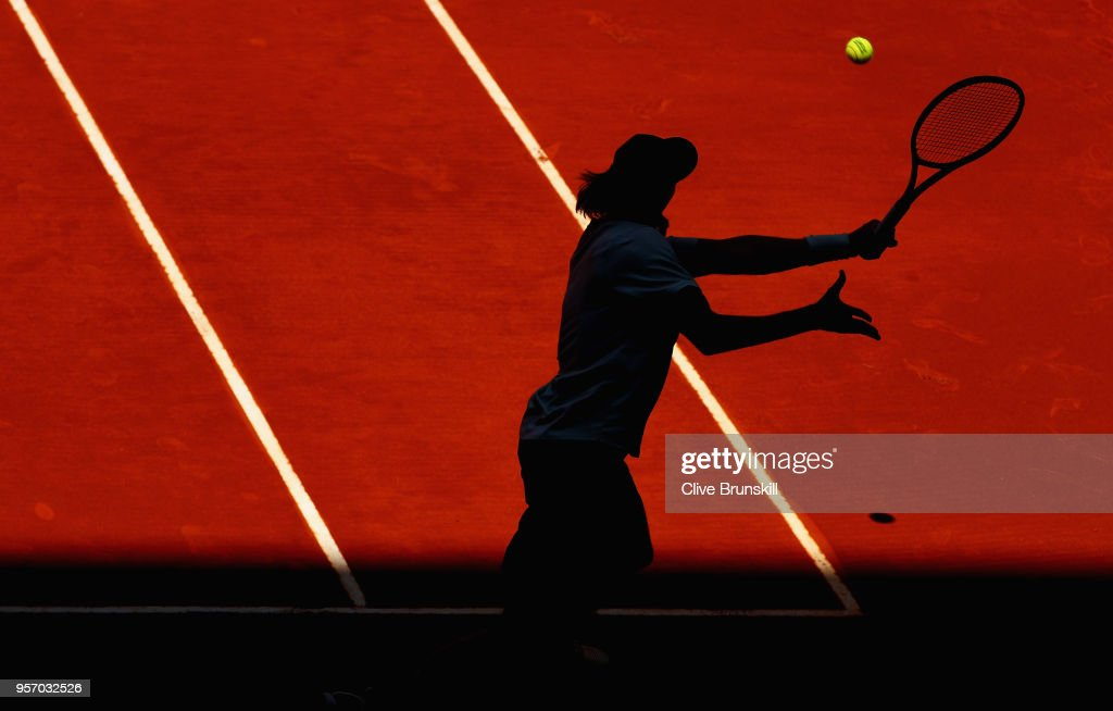 Denis Shapovalov of Canada in action against Milos Raonic of Canada in their third round match during day six of the Mutua Madrid Open tennis tournament at the Caja Magica on May 10, 2018 in Madrid, Spain.