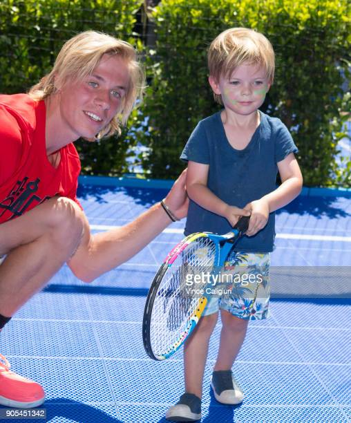 Denis Shapovalov of Canada is seen palying tennis with children in the AO BallPark activities zone on day two of the 2018 Australian Open at...