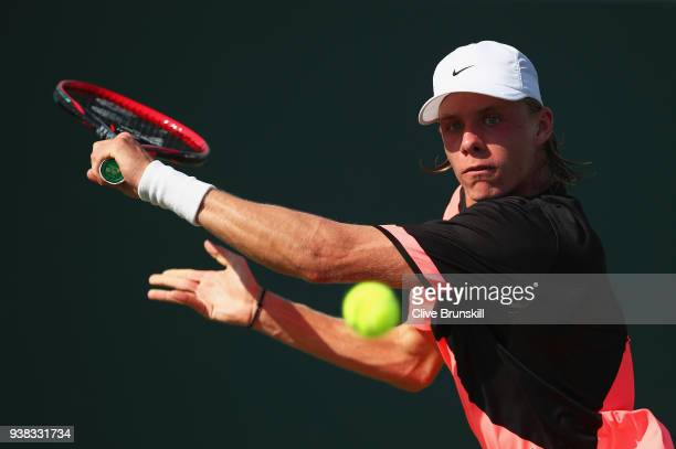Denis Shapovalov of Canada plays a backhand against Sam Querrey of the United States in their round match during the Miami Open Presented by Itau at...