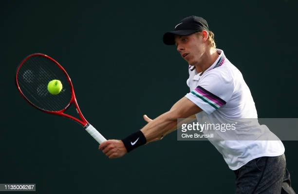 Denis Shapovalov of Canada plays a backhand against Steve Johnson of the United States during their men's singles second round match on day seven of...