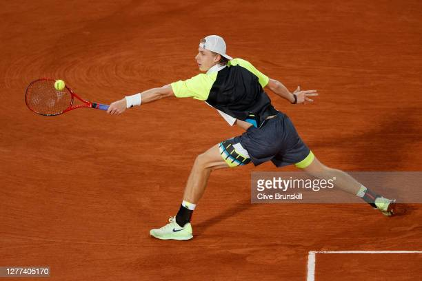 Denis Shapovalov of Canada plays a backhand during his Men's Singles first round match against Gilles Simon of France on day three of the 2020 French...