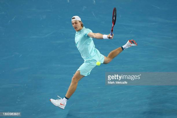 Denis Shapovalov of Canada plays a backhand during his Men's Singles first round match against Jannik Sinner of Italy during day one of the 2021...