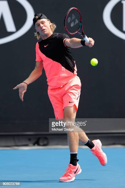 Denis Shapovalov of Canada plays a backhand in his first round match against Stefanos Tsitsipas of Greece on day one of the 2018 Australian Open at...