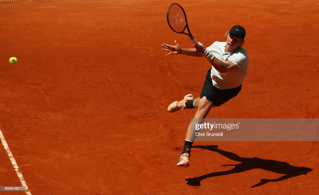 Denis Shapovalov of Canada plays a forehand against Benoit Paire of France in their second round match during day four of the Mutua Madrid Open tennis tournament at the Caja Magica on May 8, 2018 in Madrid, Spain.