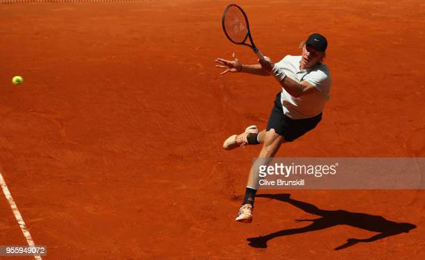 Denis Shapovalov of Canada plays a forehand against Benoit Paire of France in their second round match during day four of the Mutua Madrid Open...