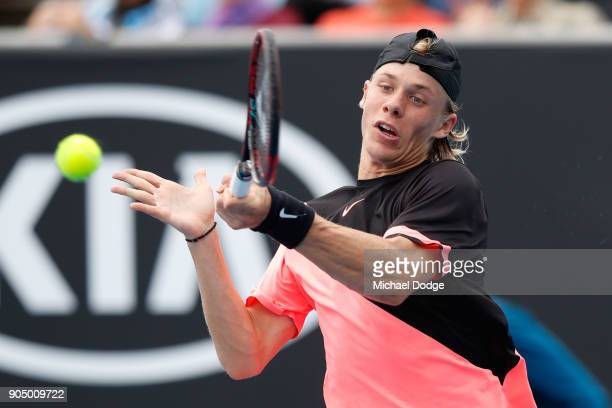 Denis Shapovalov of Canada plays a forehand in his first round match against Stefanos Tsitsipas of Greece on day one of the 2018 Australian Open at...