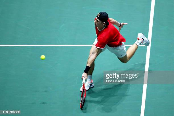 Denis Shapovalov of Canada plays a forehand in his semi final singles match against Karen Khachanov of Russia during Day Six of the 2019 Davis Cup at...