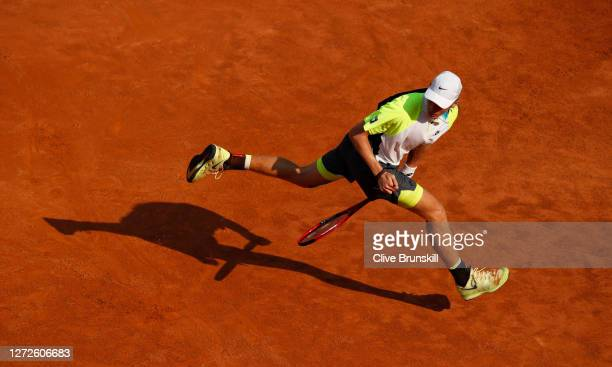 Denis Shapovalov of Canada plays a shot between his legs in his round one match against Guido Pella of Argentina during day two of the Internazionali...
