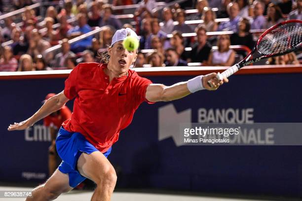 Denis Shapovalov of Canada reaches for the ball against Rafael Nadal of Spain during day seven of the Rogers Cup presented by National Bank at...