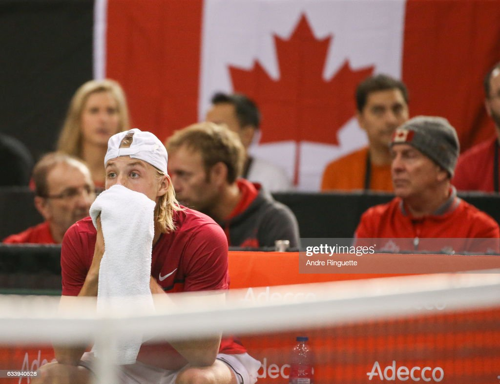 Denis Shapovalov of Canada reacts to hitting chair umpire Arnaud Gabas in the eye with a ball and forfeiting the the singles match against Kyle Edmund of Great Britain on day three of the Davis Cup World Group tie between Great Britain and Canada at TD Place Arena on February 5, 2017 in Ottawa, Ontario, Canada.