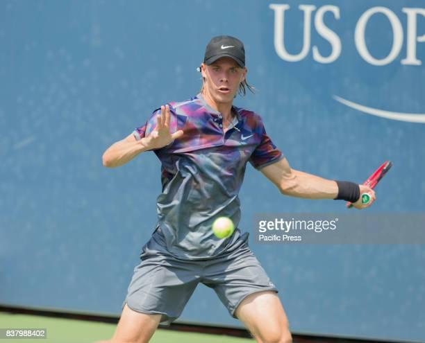 Denis Shapovalov of Canada returns ballduring qualifying game against Denis Kudla os USA at US Open 2017