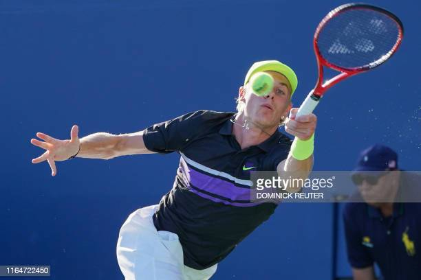Denis Shapovalov of Canada returns the ball against Henri Laaksonen of Switzerland during their Round Two Men's Singles tennis match during the 2019...